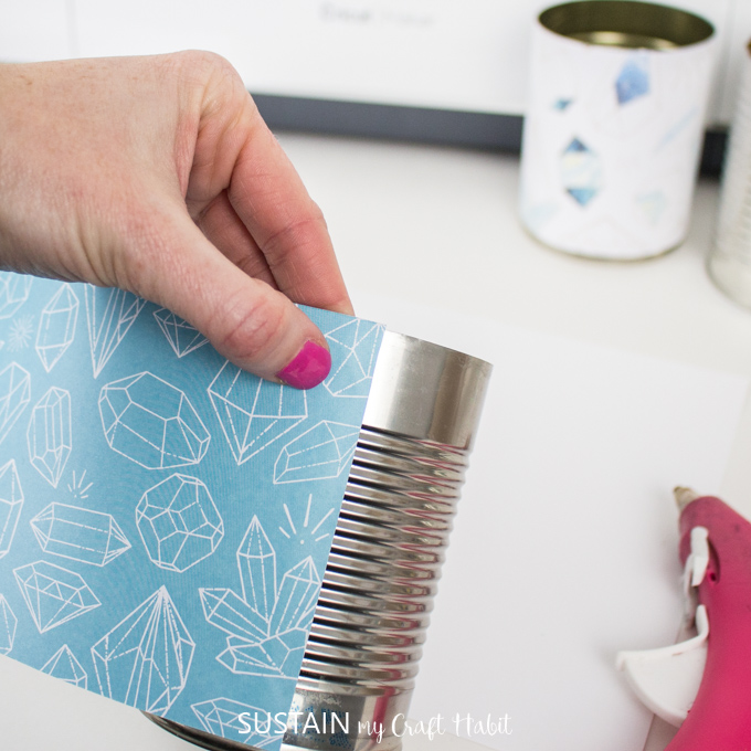 wrap and glue Cricut Deluxe Paper around a tin can