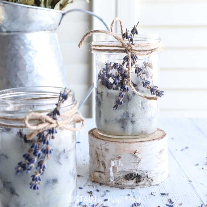 Close up of the mason jar lavender candles wrapped with twine and dried lavender.