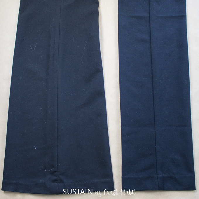 Two dark blue pant legs showing the dfference between a flared leg versus a straight leg style.