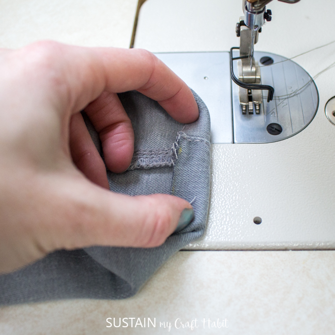 folding the new hem for a stitched hem