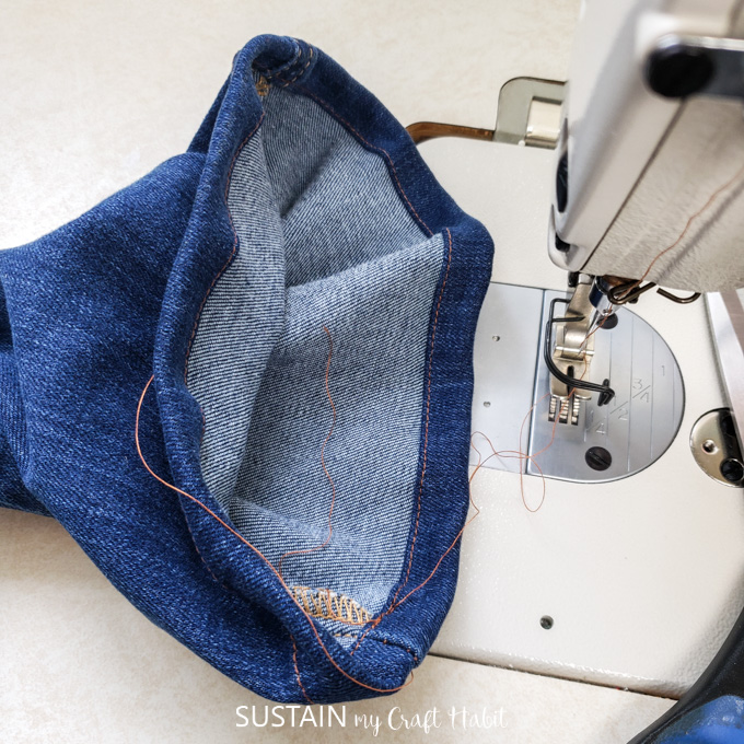 Stitching a new pant hem with a sewing machine.