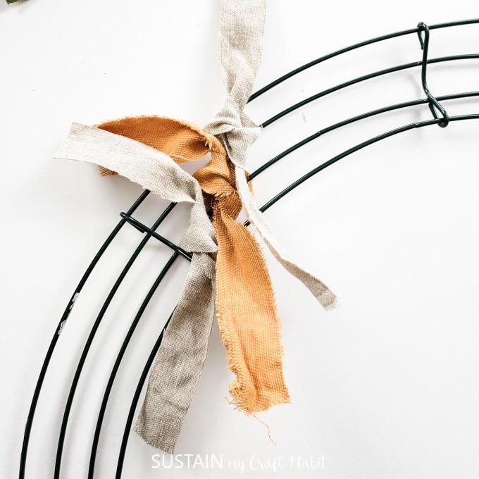 tie third strip around wire form
