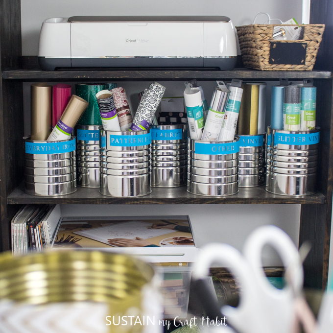 organization labels using Cricut Maker and Premium Vinyl on coffee tins to store Cricut vinyl.
