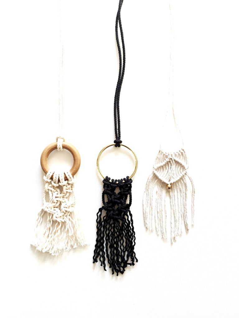 Close up image of 3 necklaces made form this DIY macrame kit.