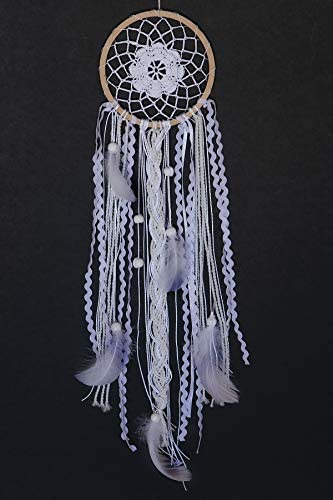 A complete dream catcher against a black background.