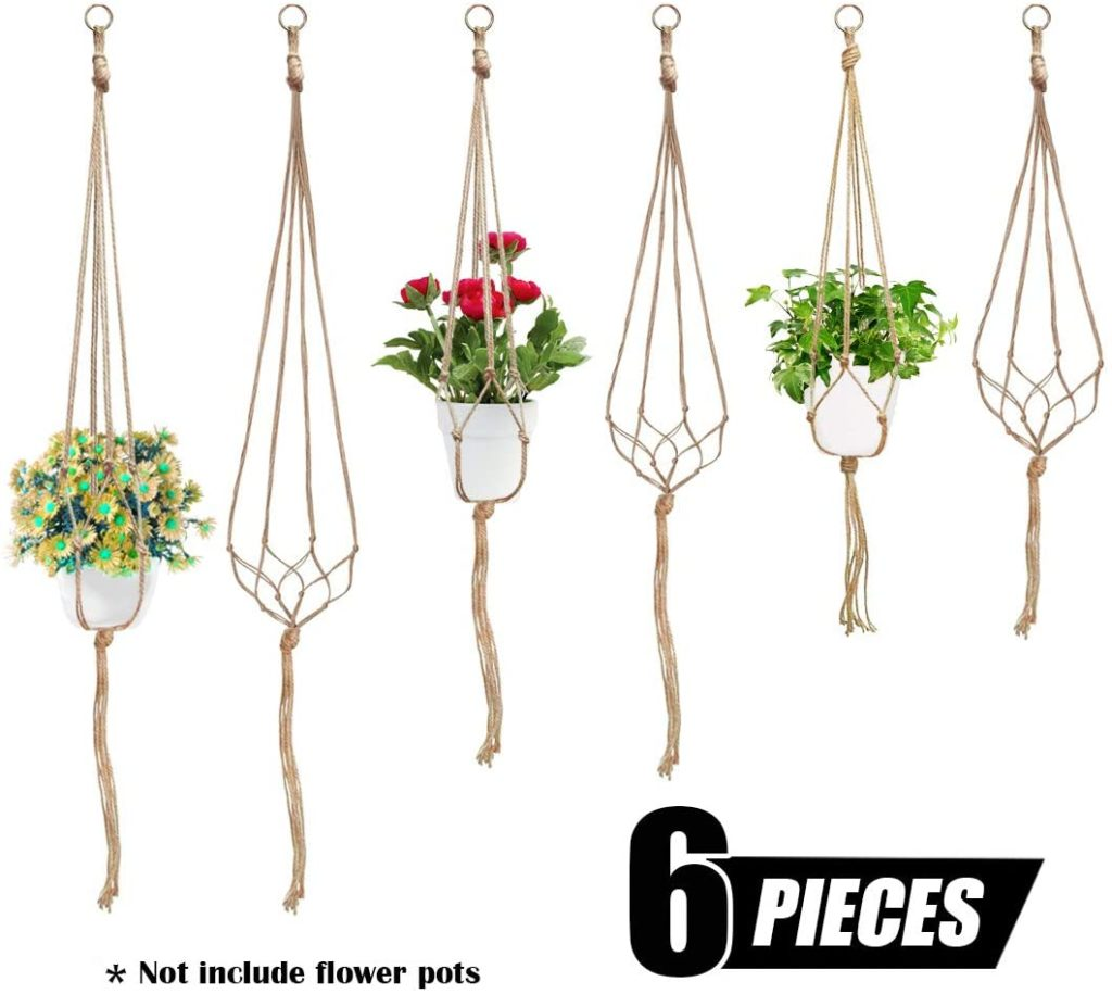 Six completed macrame plant hangers against a white background as an example of the final contents of this beginner macrame kit.