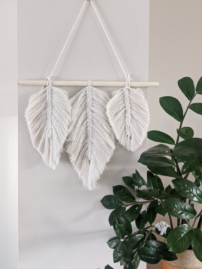 Completed macrame leaf wall hanging made from a DIY macrame kit.