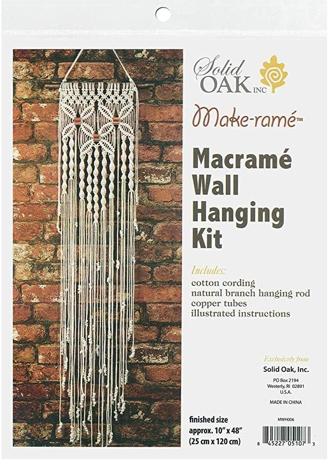 Package cover of a DIY macrame kit showing a completed wall hanging.