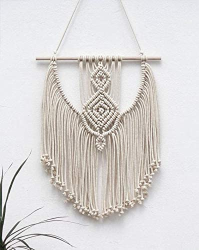 Completed macrame wall hanging.
