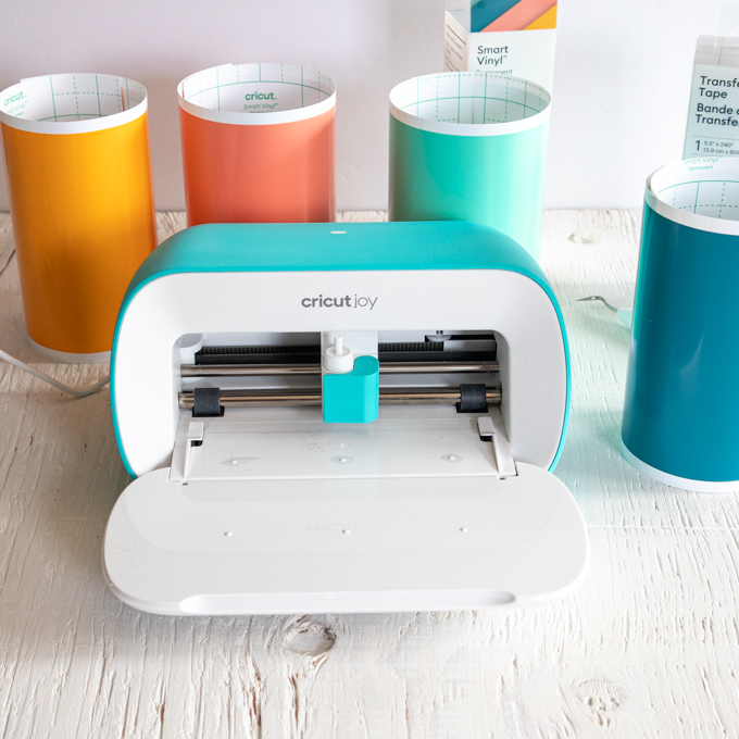Cricut Joy machine and vinyl.