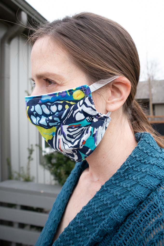 wearing a simple pleated face mask