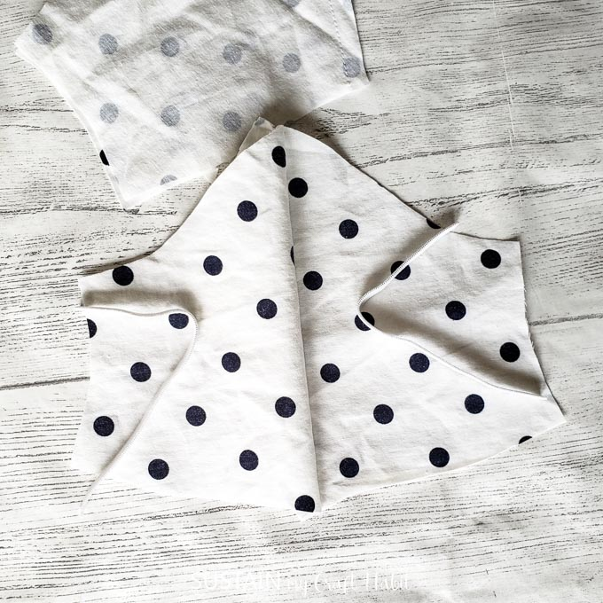 Adding white elastic to the ends of the polka dot fabric.