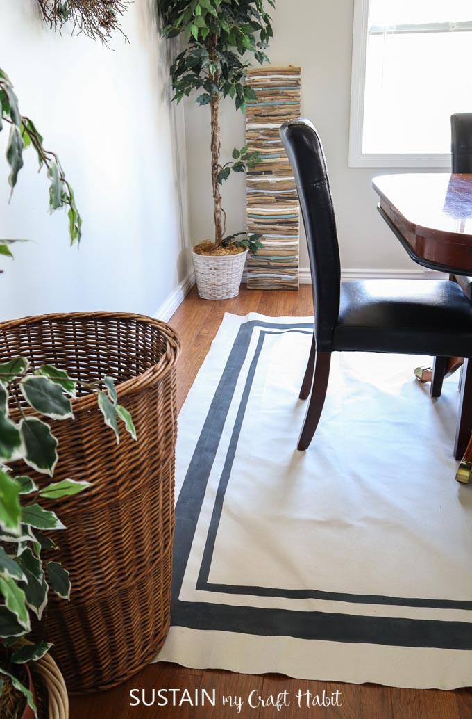 simple DIY canavs rug with painted stripes styled in a dining room