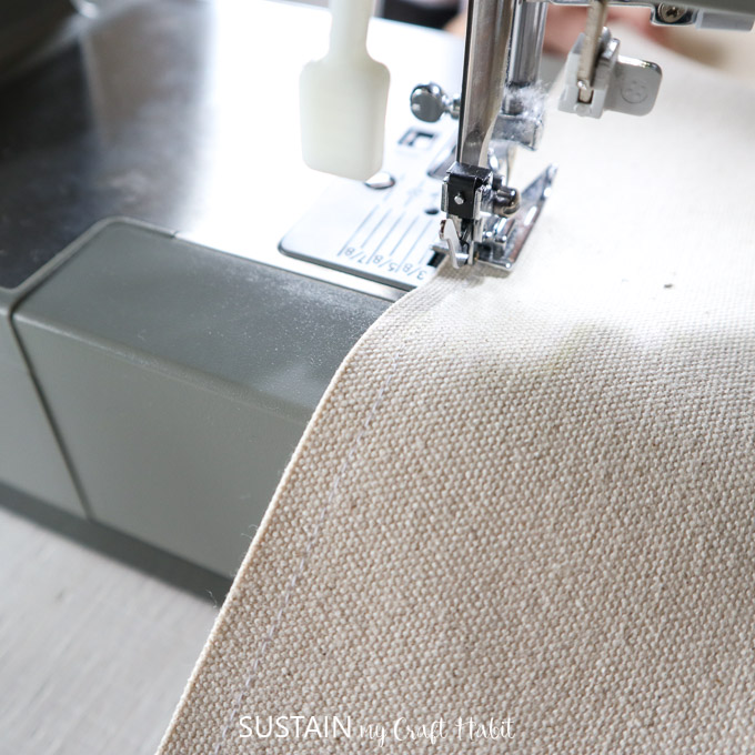 adding a single needle topstitch along the cut edge to prevent the canvas fabric from fraying