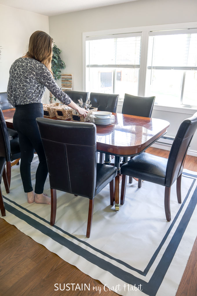 large canvas painted rug underneath a dining room table