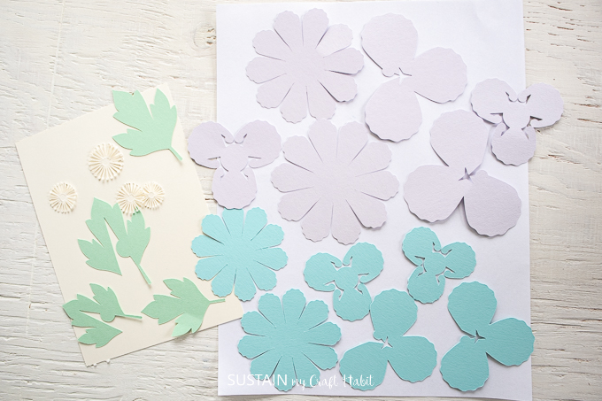 white, green, blue and purple cut out pieces.