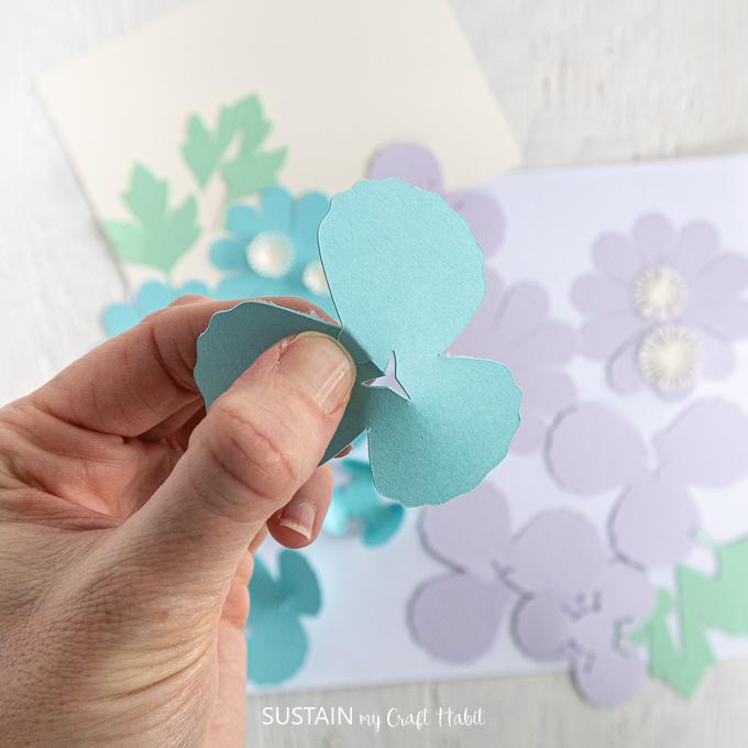 Folding the blue petal.