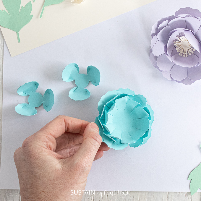 Adding a petal to the top of other petals.
