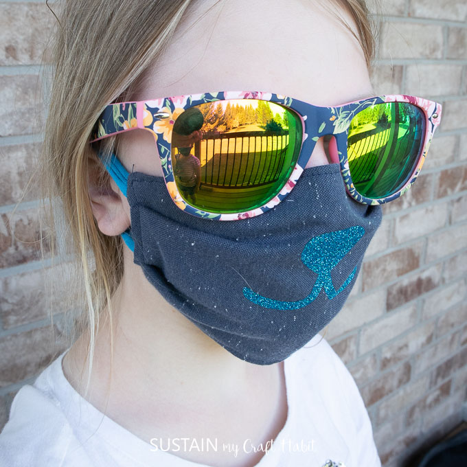 child age 8 wearing a reusable face mask made from upcycled shirts