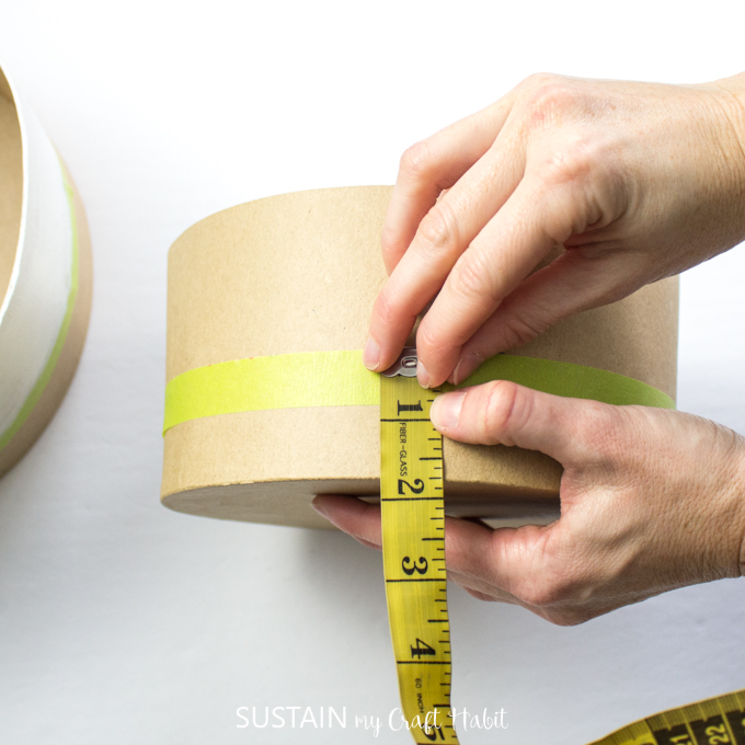 "Using a measuring tape to measure 1 3/4"" from the bottom of the box."