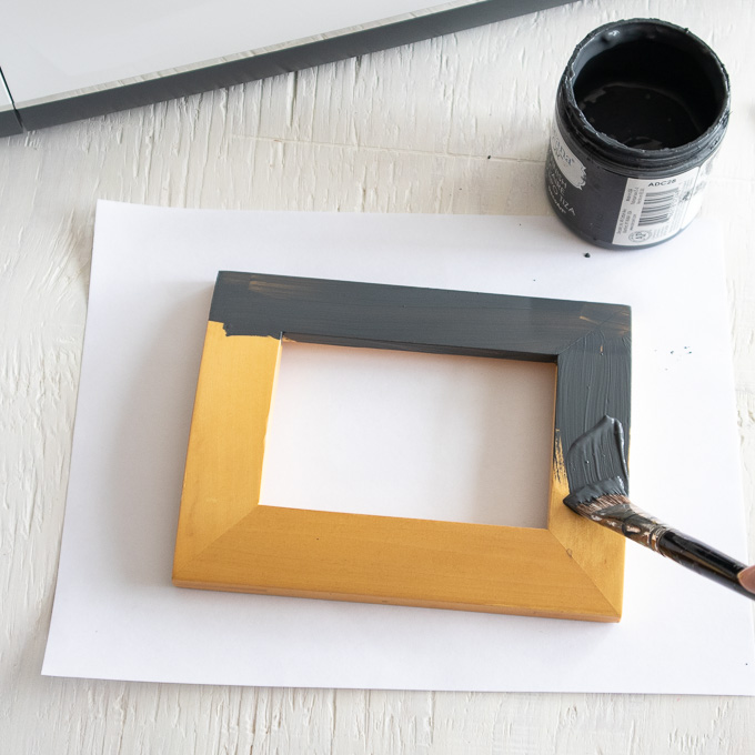 Painting a wood photo frame with charcoal colored paint.