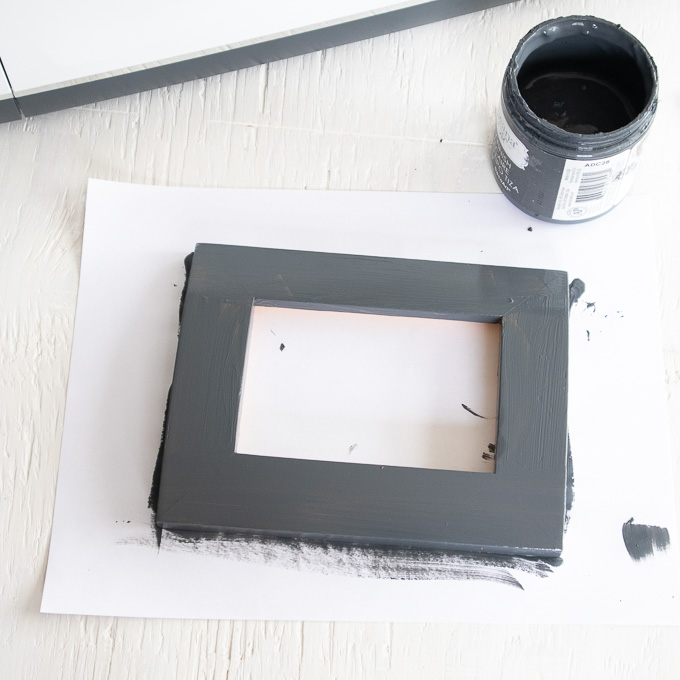 Photo frame after being painted with charcoal colored paint.