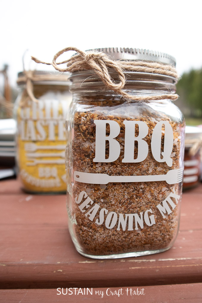 Mason jars labelled as BBQ seasoning sitting on a table.