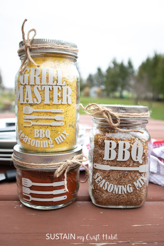 "Three mason jars filled with BBQ seasoning and labelled with phrases such as ""grill master"" and "" BBQ Seasoning mix."" as a Father's Day BBQ gift idea"