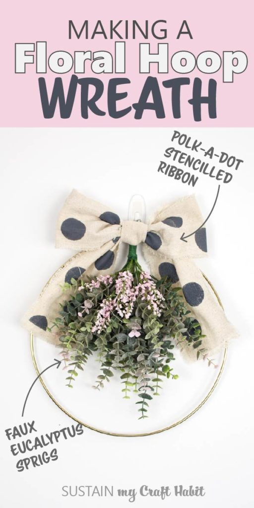 "Gold hoop wreath made with eucalyptus plants, pink flowers and a polka dot canvas bow with text overlay ""Making a floral hoop wreath."""