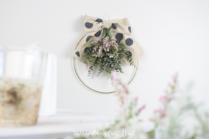 Finished floral hoop wreath hanging on the wall.