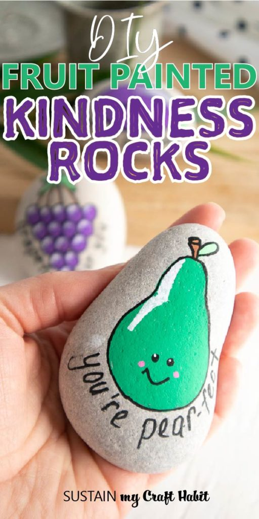 "Close up of a rock painted with a pear and text overlay ""DIY fruit painted kindness rocks."""