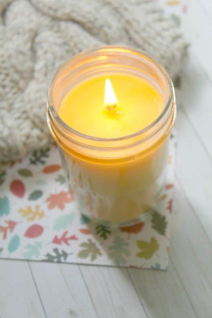 Lit mason jar candle.