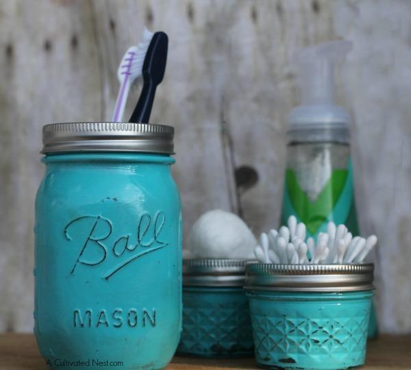 Ball jars and small glass jam jars painted teal