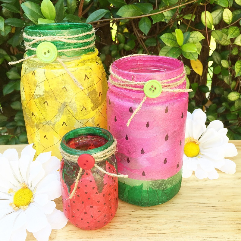 Mason jars painted to look like a strawberry, watermelon and lemon.