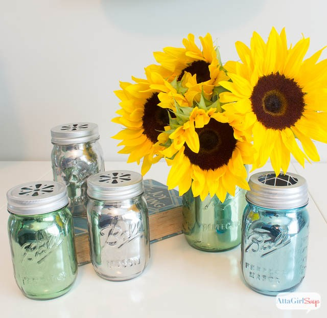Mason jar crafts made into mirrored flower vases.