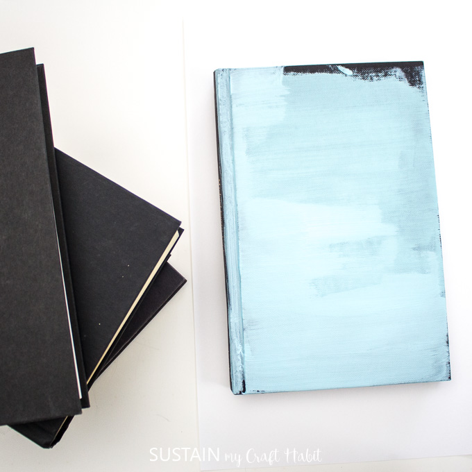 Hardcover book painted blue.