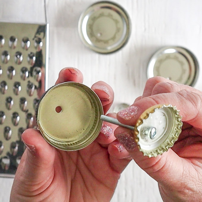 Stacking a bottle cap into a mason jar lid with a screw.