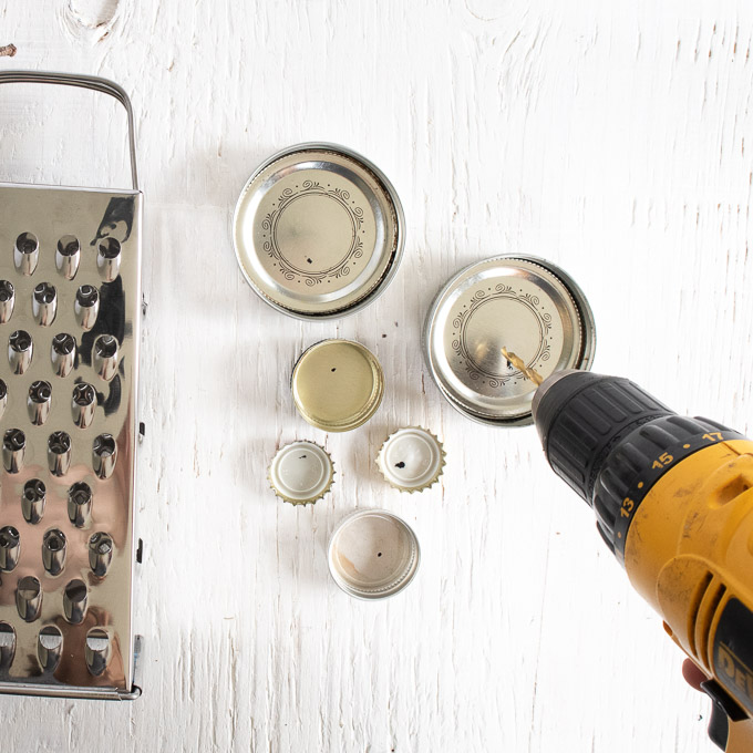Drilling holes into the mason jar lids and bottle caps.