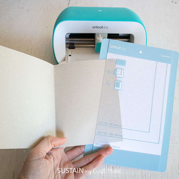 Sliding a folded card into a plastic divider.