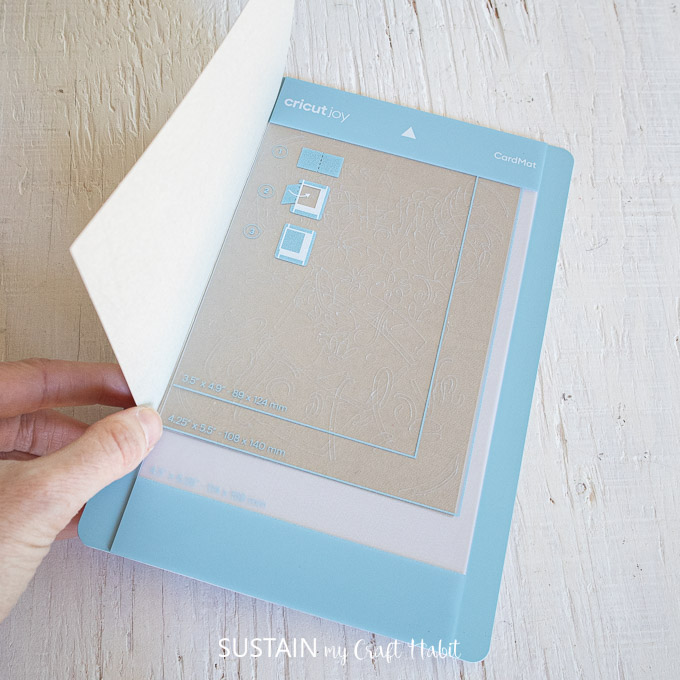Aligning a folded card with the plastic divider.