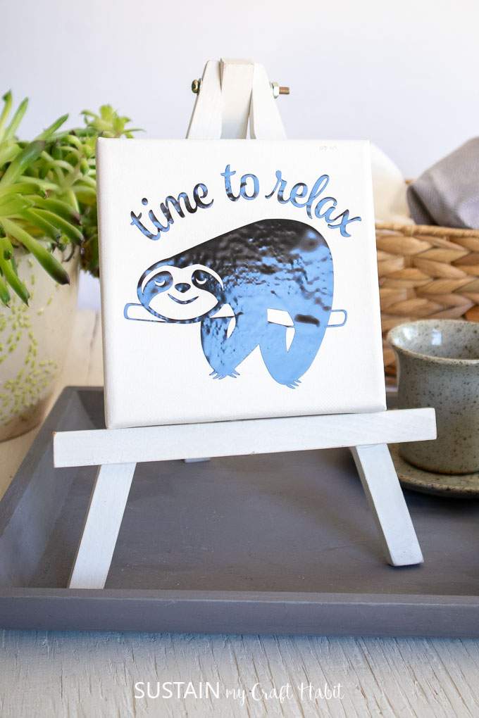Mini canvas sloth art image on a white easel, sloth svg free