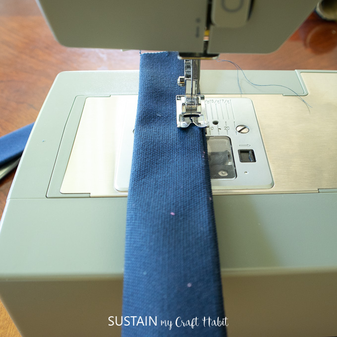 Sewing the straps for the handles of the DIY storage cubes.