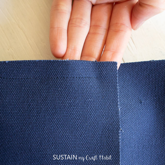 """Close of image of blue canvas fabric with a 1/2"""" seam allowance."""