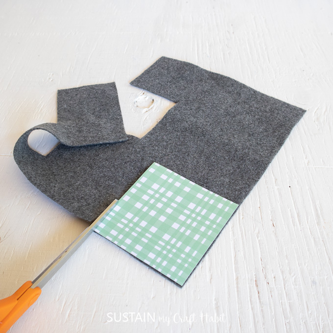 Cutting four pieces of felt fabric.