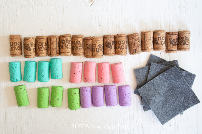 Gathering all of the materials and sorting the painted wine corks by color.
