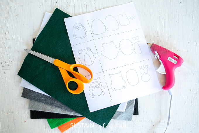 Materials needed to make these felt animals pencil toppers including felt fabric, scissors, hot glue gun and printable template.