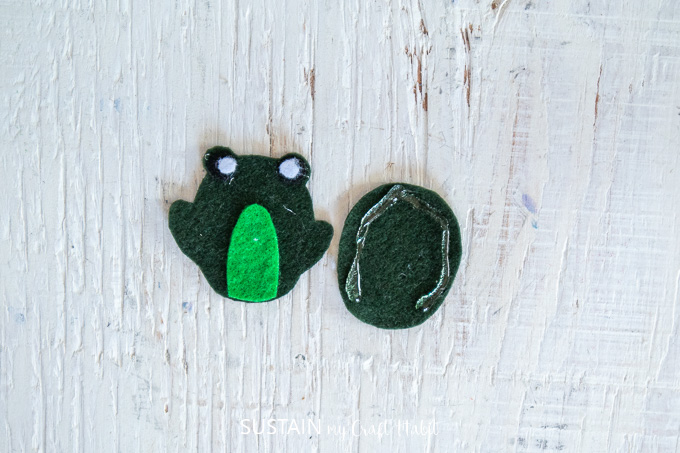 Gluing two of the green felt fabric to make a frog.