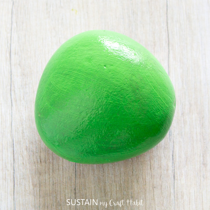 A green painted rock.