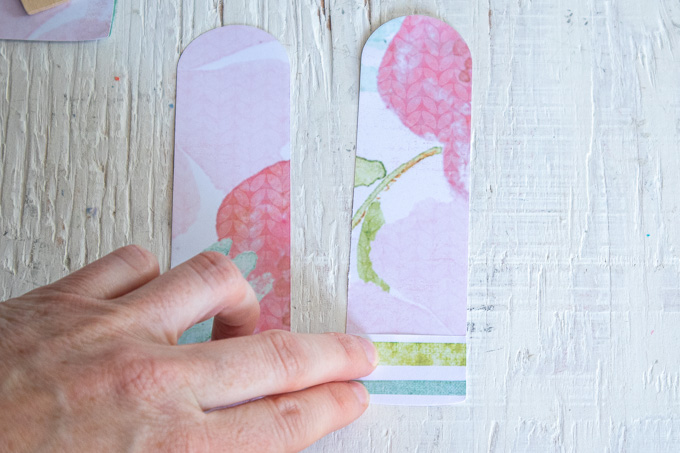Gluing small pieces of paper onto the popsicle cut out.