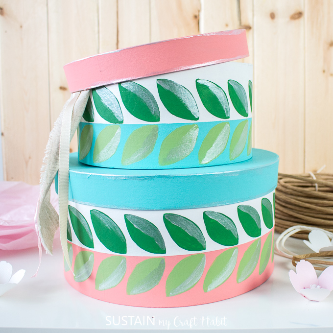 pretty painted craft hat boxes used to hold ribbons and twine.